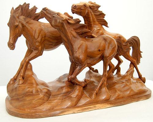 wood carved horses